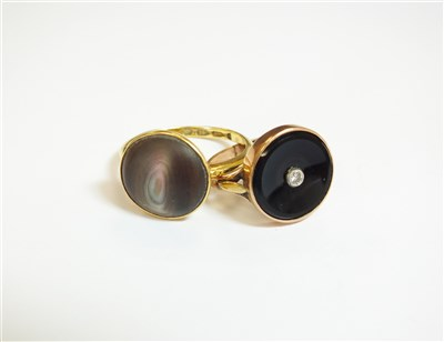 Lot 25-An abalone shell ring and an onyx ring