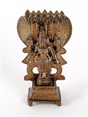 Lot 527-A small Indian cast bronze altar figure in the form of Shiva
