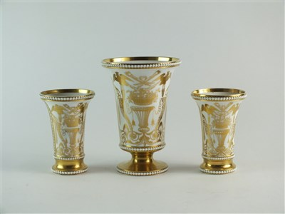 Lot 63-A garniture of three Spode match pots