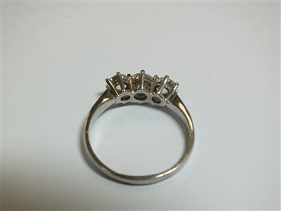 Lot 258-An 18ct gold three stone diamond ring