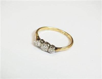 Lot 27-A three stone diamond ring