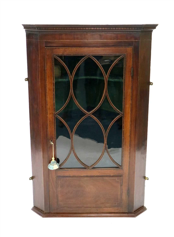 Lot 229-A George III mahogany veneered wall-hanging corner cupboard