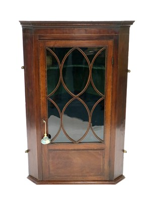 Lot 229-A George III mahogany veneered wall-hanging corner cupboard