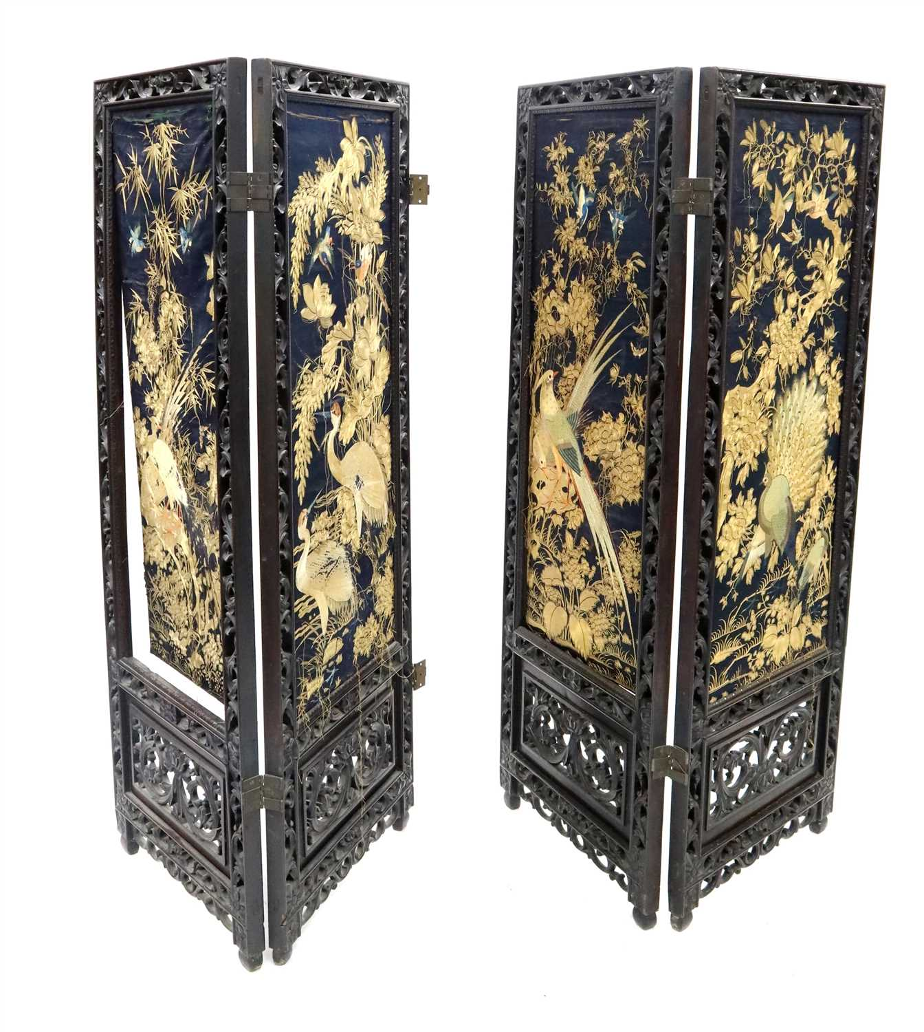 565 - A large 19th century Chinese carved hardwood four-fold screen with inset upholstered panels