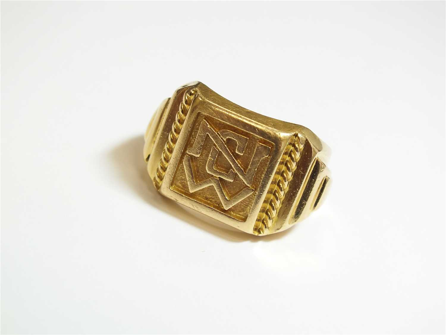 Lot 2-A yellow metal signet ring