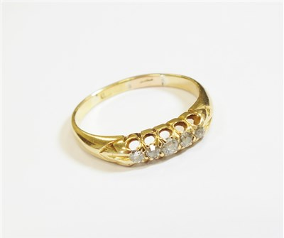 Lot 1-An 18ct gold five stone diamond ring