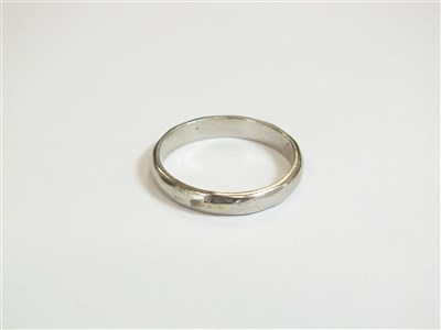 Lot 9-A white metal wedding band