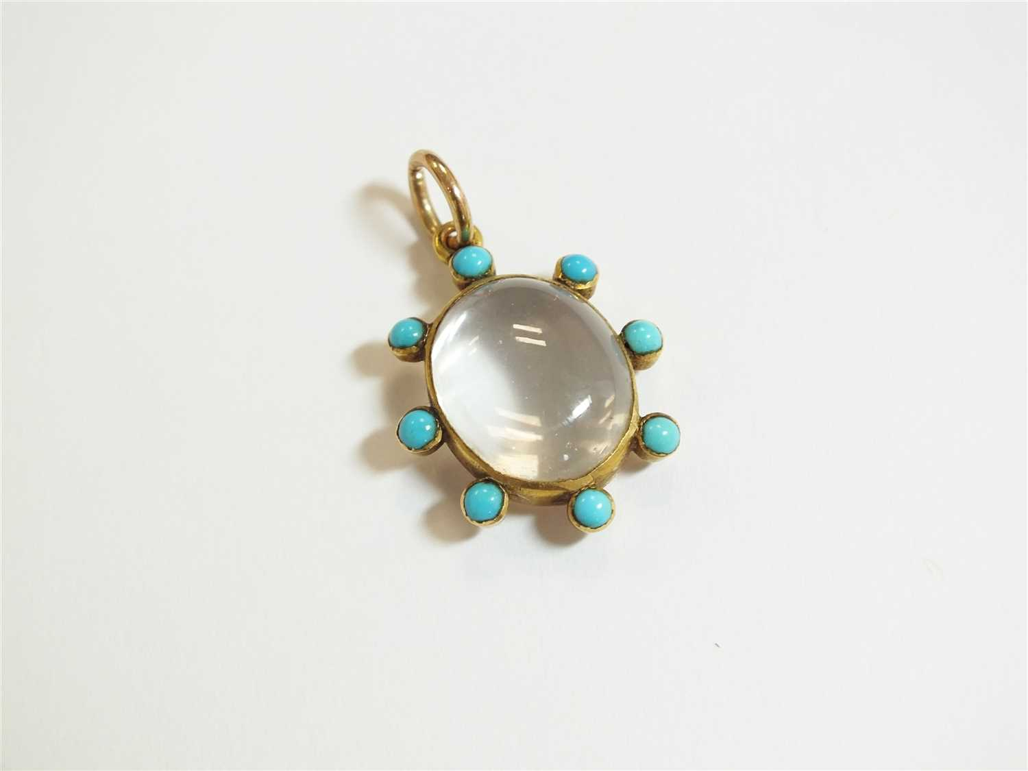 Lot 10-A 19th century turquoise and rock crystal locket pendant