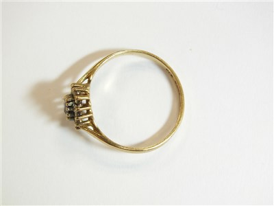 Lot 15-Two rings and a brooch