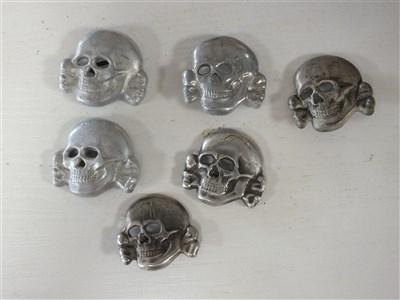 Lot 316-Six SS-style cap eagles and six skulls