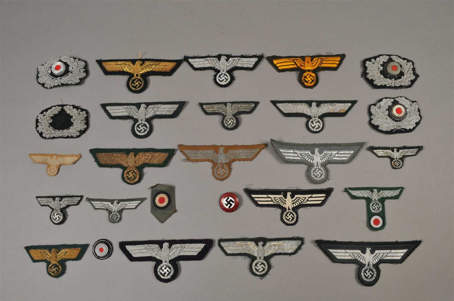 Lot 618-Over 50 German Third Reich cloth badges - including reproduction
