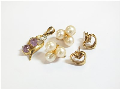 Lot 34-Two pairs of earrings and a pendant