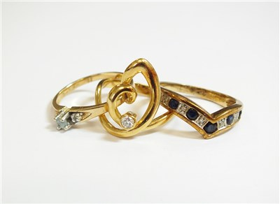 Lot 35-Three stone set rings