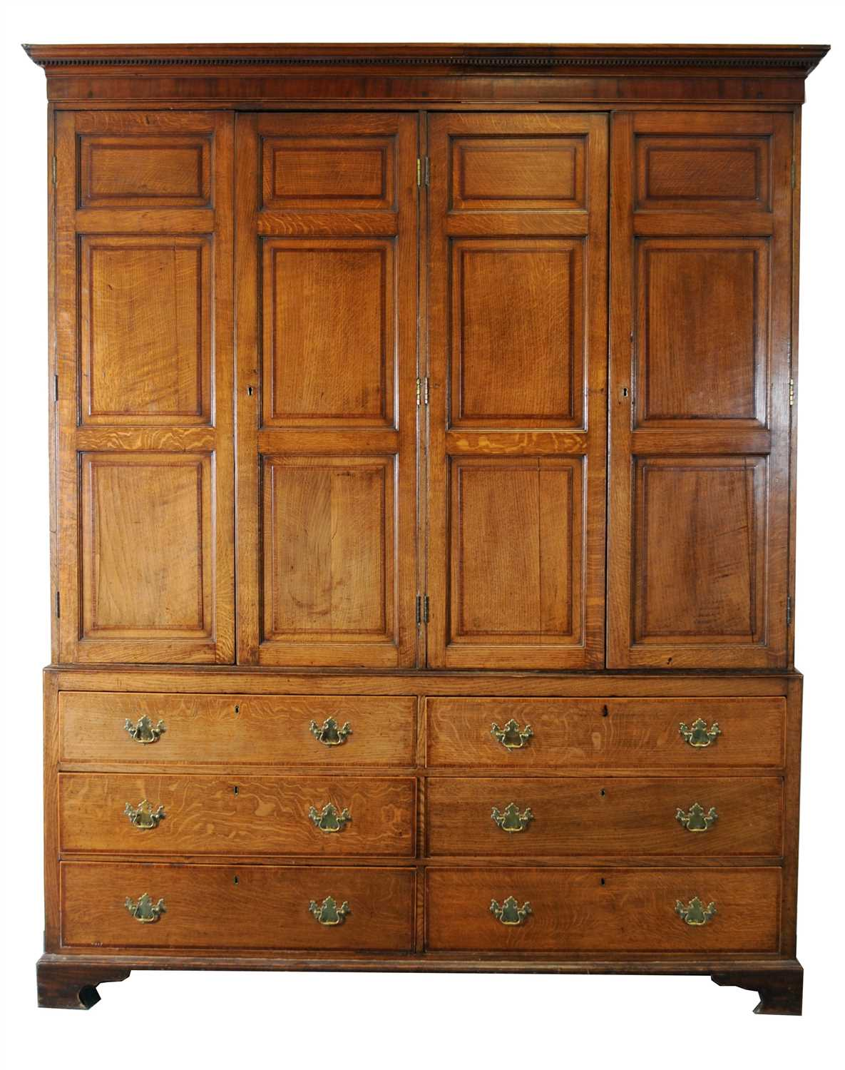 Lot 766-A large and impressive George III country house cross-banded oak livery cupboard