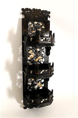 Lot 536-A Japanese Meiji period carved hardwood wall hanging three tier display stand