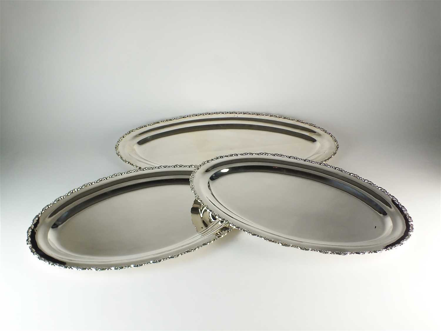 Lot 214-Three Egyptian silver platters