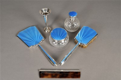 Lot 64-A collection of silver and blue guilloche enamel mounted dressing wares