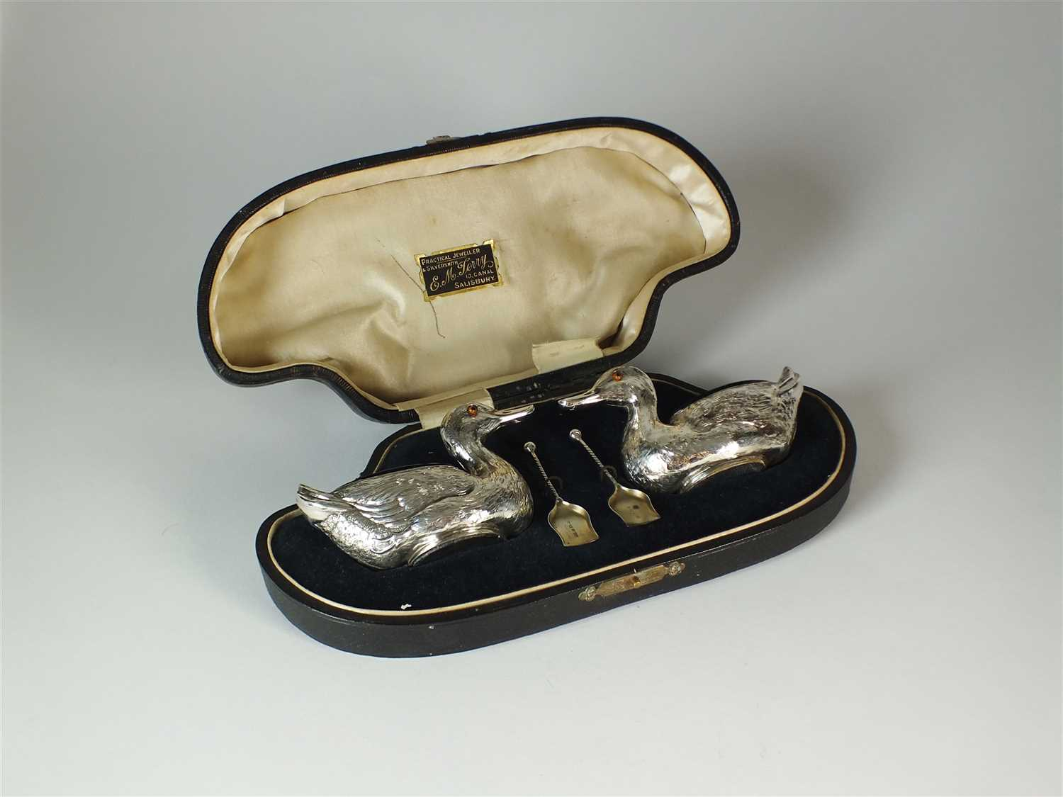 227 - A cased pair of Edwardian novelty silver duck salts
