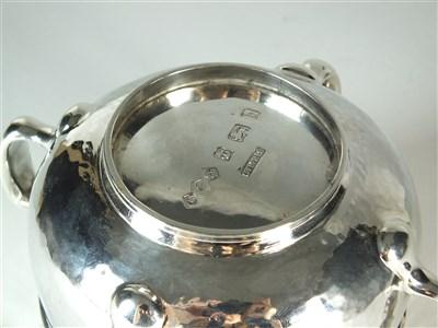 Lot 234 - A Liberty & Co Cymric silver four handled bowl