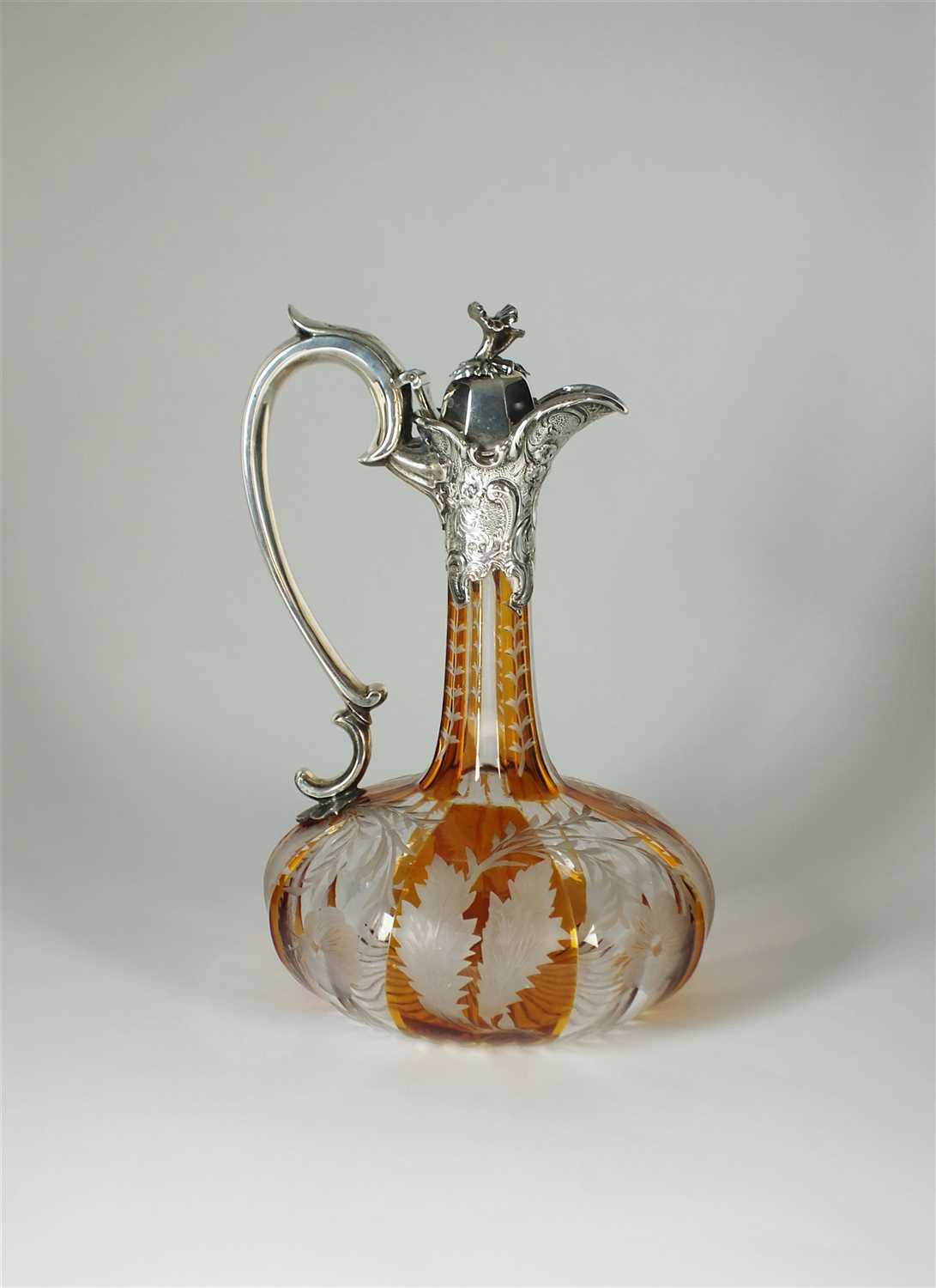 176 - An early Victorian silver mounted amber flashed glass claret jug