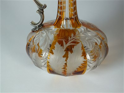 Lot 176 - An early Victorian silver mounted amber flashed glass claret jug