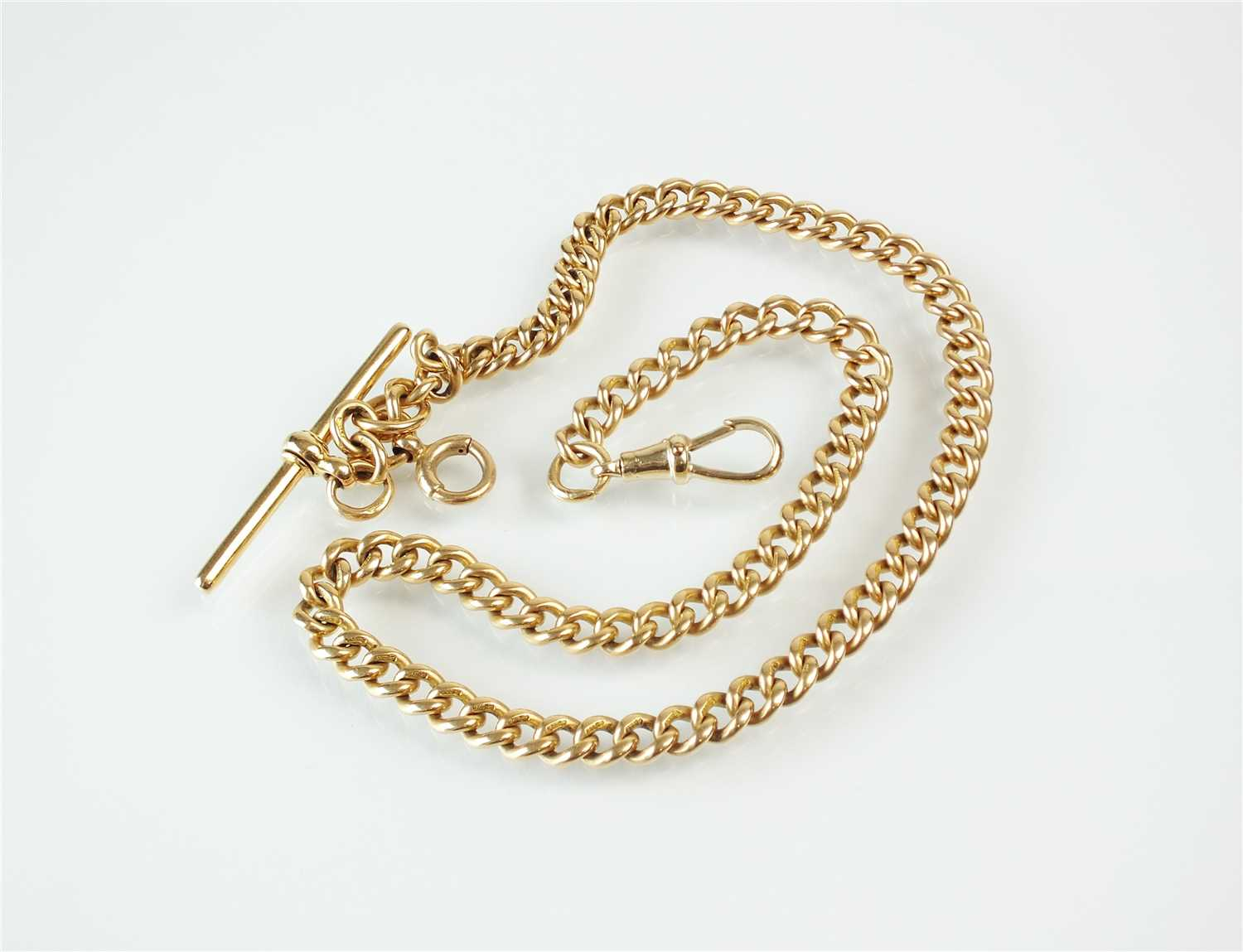 Lot 284-A 15ct gold curb link Albert