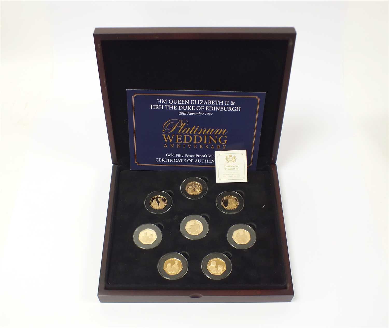 Lot 447 - Isle of Man platinum wedding anniversary gold proof eight 50 pence set