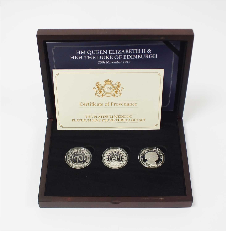 Lot 451-Bailiwick of Guernsey, Isle of Man & Jersey platinum wedding anniversary five pound three coin set