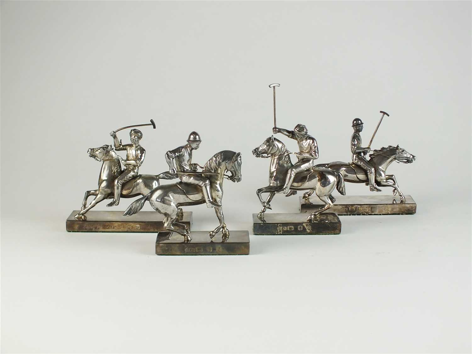 47 - A set of four silver Polo match models