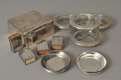 Lot 1-Four match box holders, together with four white metal mounted glass ash trays, a silver mounted cigar box and four ash trays