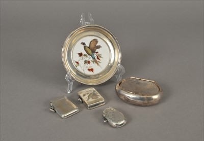 Lot 4-Three silver vesta cases, a white metal mounted ceramic dish and a silver tobacco box
