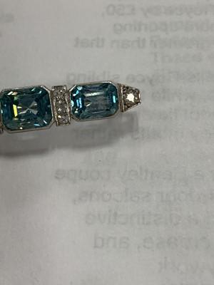 Lot 60 - An Art Deco blue zircon and diamond bar brooch