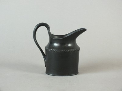Lot 238 - A rare Caughley black basalt cream jug