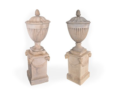 Lot 479 - A pair of Coade urns, with bud form finials...