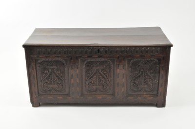 Lot 25 - A 17th century oak coffer, the twin panel top...