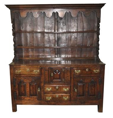 Lot 28 - An early-mid 18th century oak dresser, North...