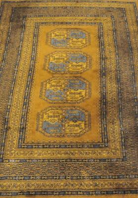 Lot 22 - A Turkoman style rug, the central panel with...