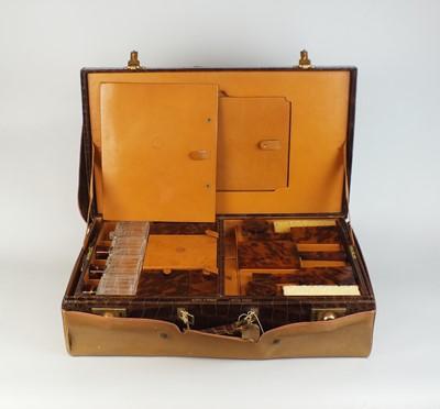 Lot 20 - An early 20th century crocodile vanity case