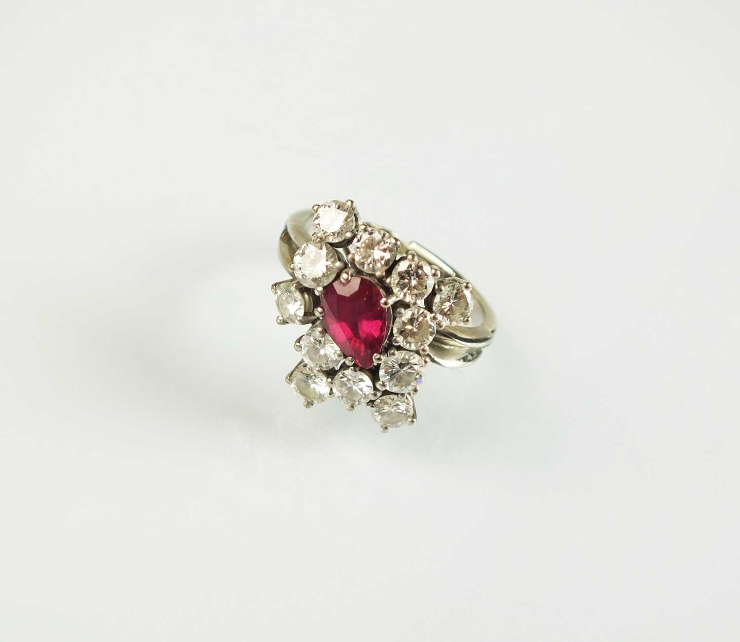 Lot 70 - A ruby and diamond dress ring