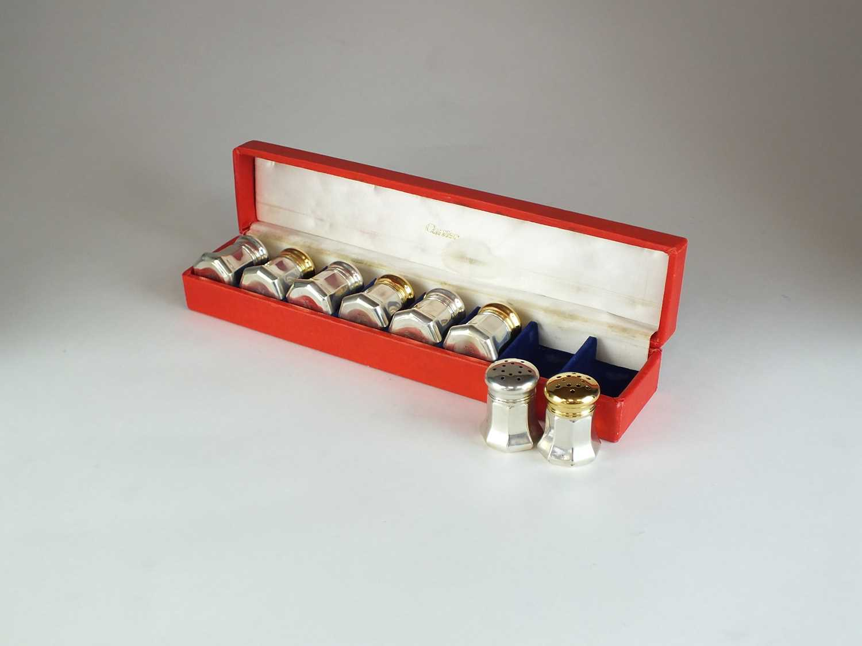 Lot 9 - A set of silver gilt Cartier salt and pepper shakers