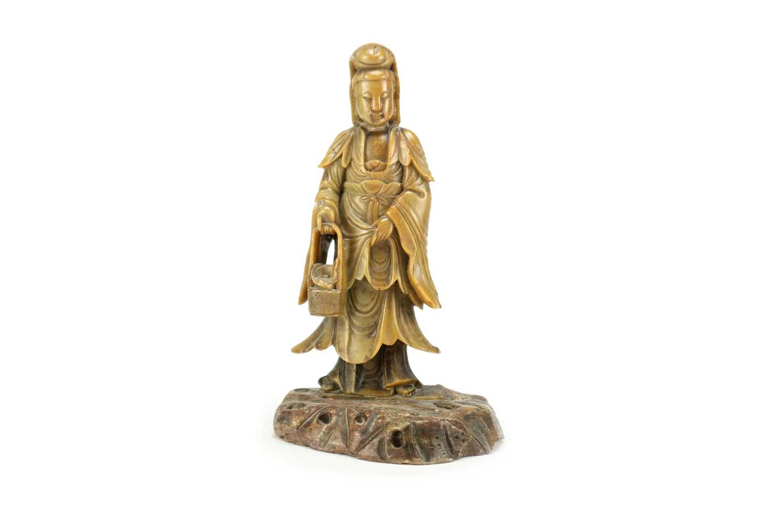 Lot 329 - A Chinese soapstone figure Guanyin, Qing Dynasty