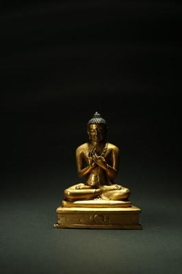 Lot 337 - A good Tibetan gilt copper alloy figure of Shakyamuni Buddha, 15th century