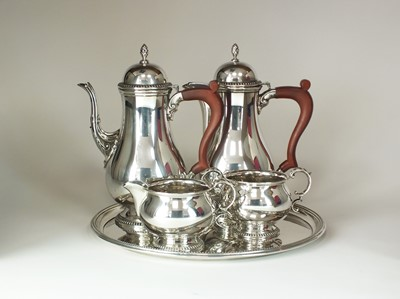 Lot 23 - A George III style four piece silver coffee service and tray