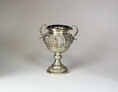 Lot 10 - A 19th century Indian white metal twin handled urn