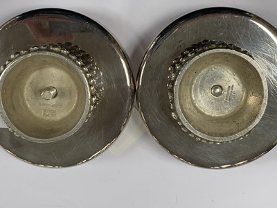 Lot 4 - A pair of silver plated short candlesticks