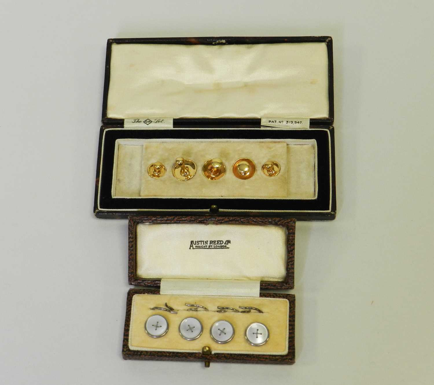 Lot 23 - A cased collection of graduated yellow metal studs