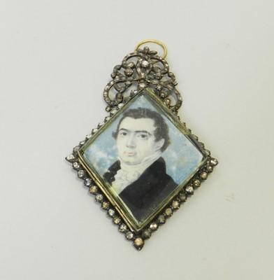 Lot 24 - An early 19th century rose cut diamond set miniature portrait pendant