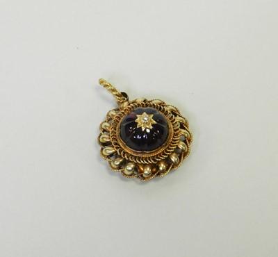 Lot 28 - A Victorian style garnet and diamond locket pendant