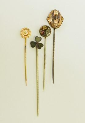 Lot 31 - Four stick pins