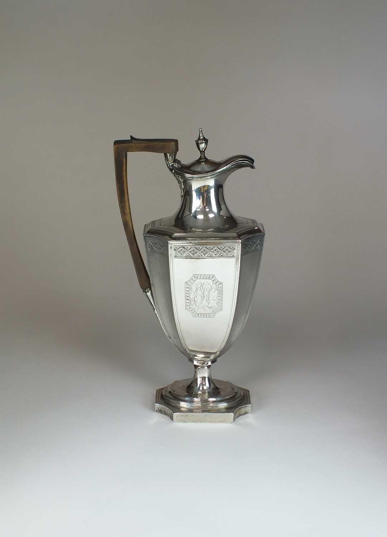 Lot 5 - A George III silver hot water jug